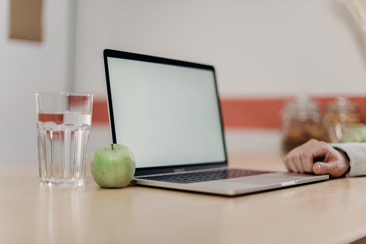 Green Apple Fruit Beside Black Tablet Computer on Brown Wooden Table